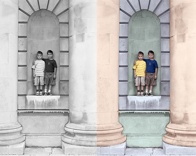 Colorized photo showing two boys standing between pillars